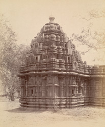 Close view of the shrine walls and shikhara of the Santeshvara Temple, Tillivalli, showing moulding and sculptural detail